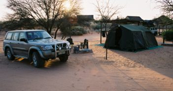 Camping site with Nissan Patrol and tents